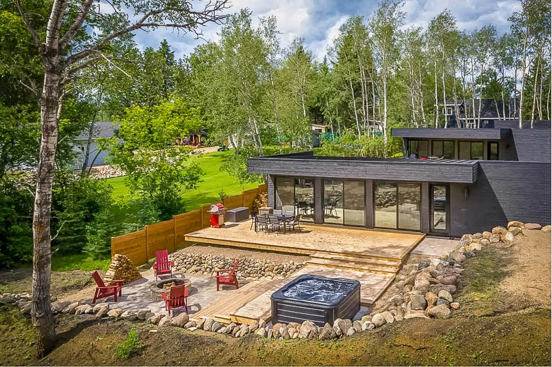 Outdoor deck area with hot tub and firepit