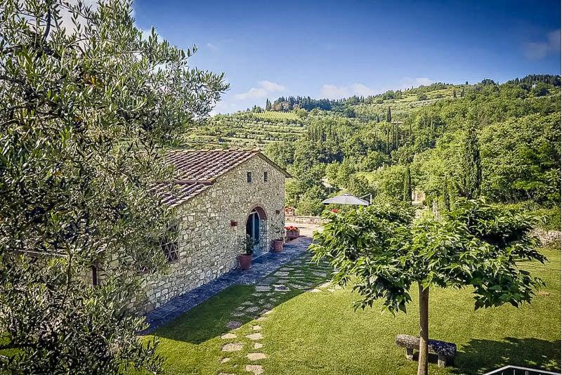 An Airbnb Tuscany farmhouse next to a vineyard