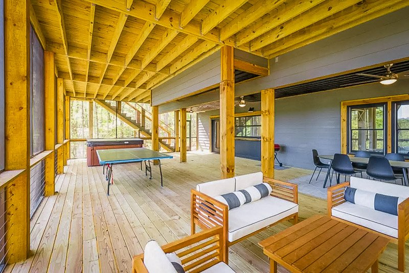 Covered deck area with entertainment room.