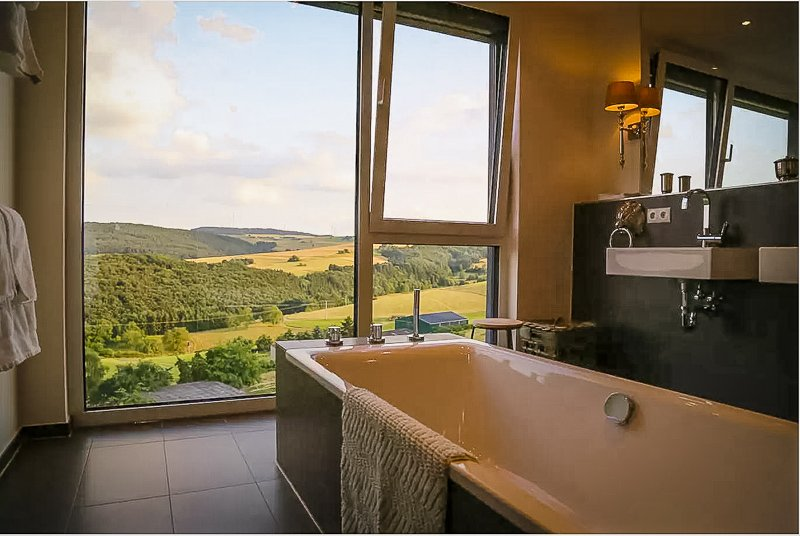 Large bathroom tub facing the German countryside