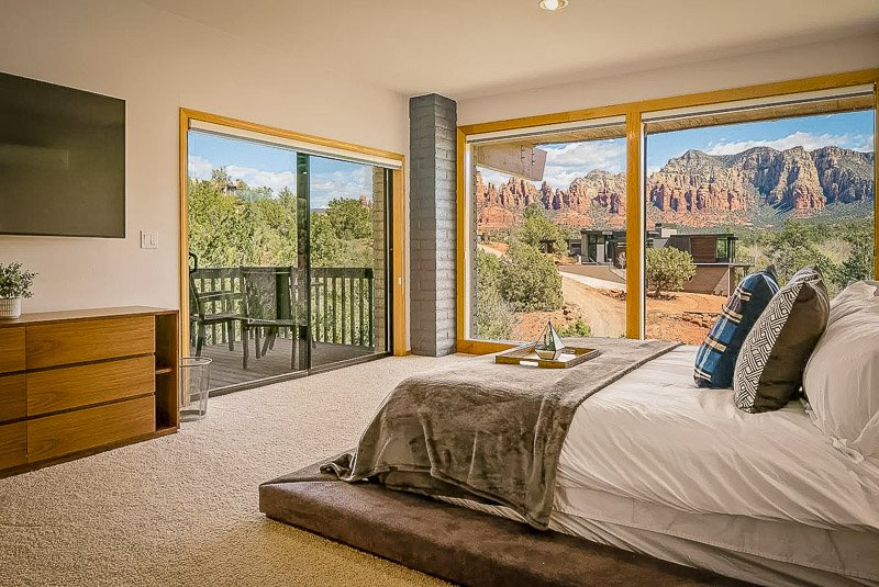 Master bedroom with its own private balcony and gorgeous mountain views