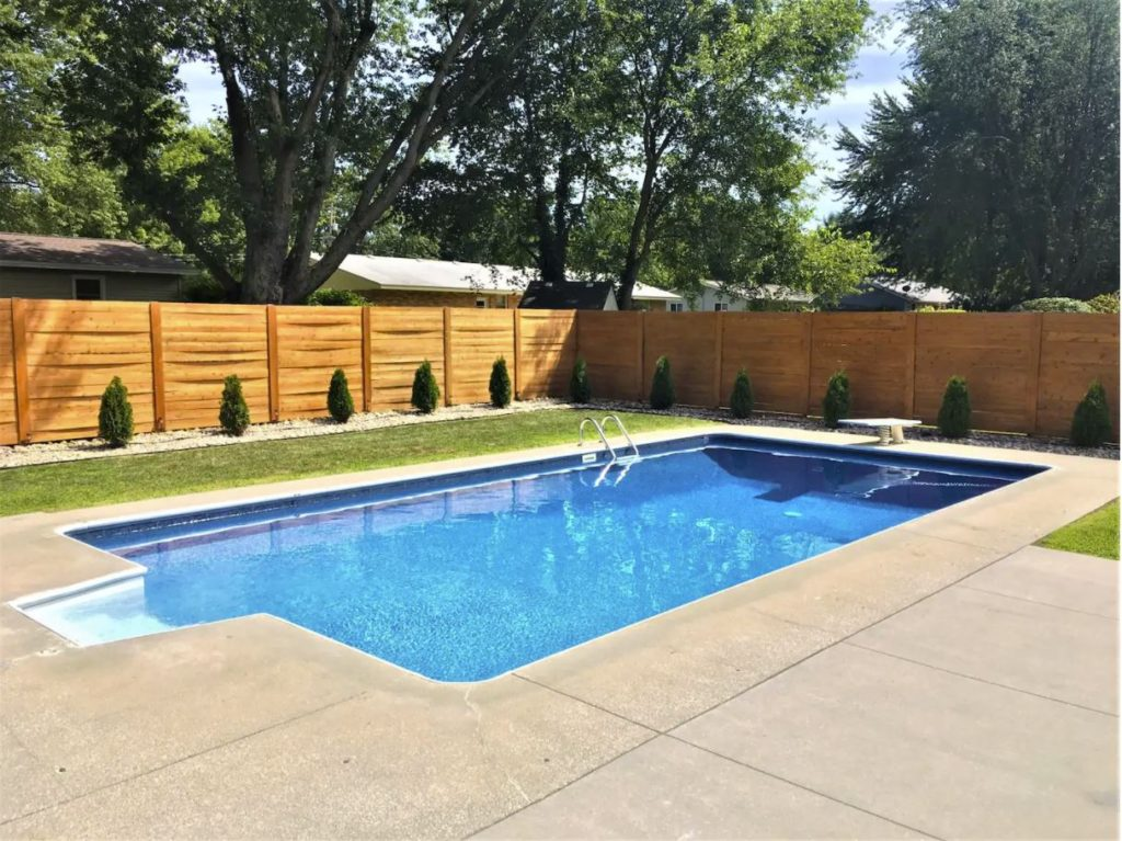 A home for rent in Michigan with an outdoor pool.