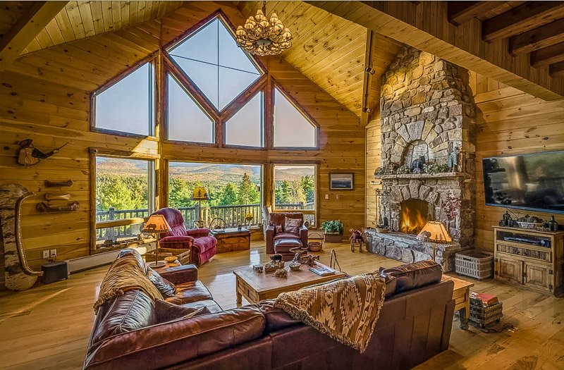 Stunning living room with an indoor fireplace and sweeping mountain vistas