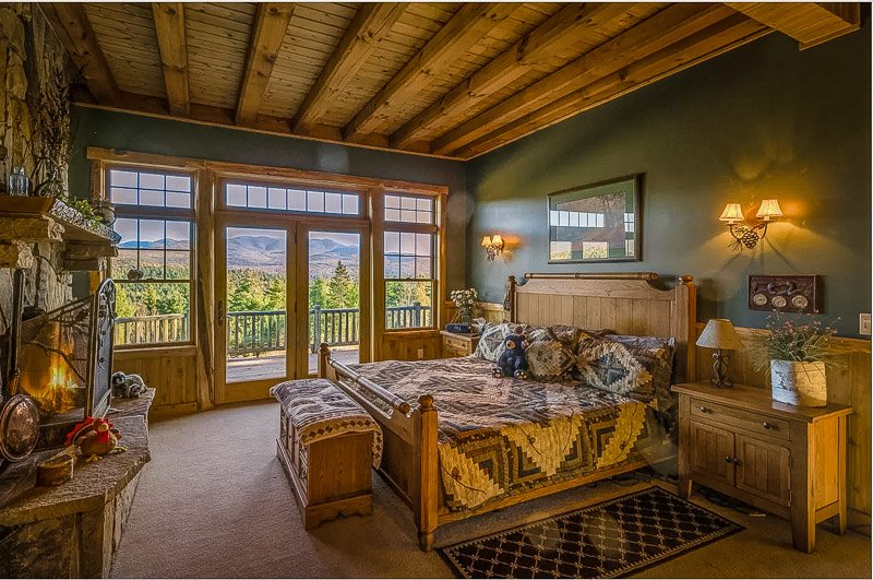 Master bedroom with a private balcony overlooking the Adirondacks