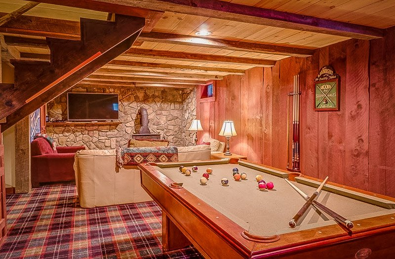 Downstairs game room inside the VT log cabin rental.
