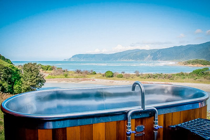 Outdoor soaking tub with a view.