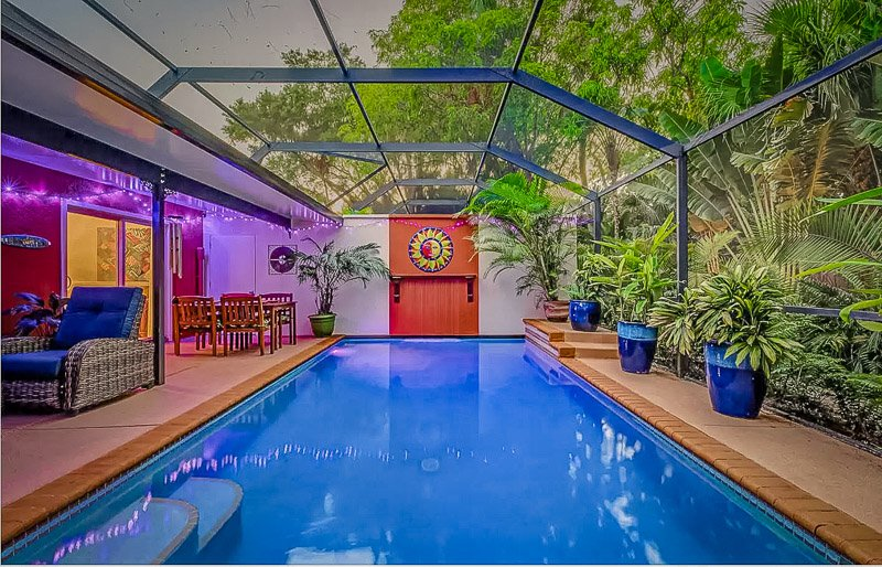 Screened-in heated pool in the backyard of this Florida vacation rental.