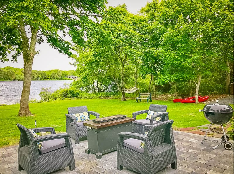 Spacious patio and backyard outside of this top vacation rental in Massachusetts
