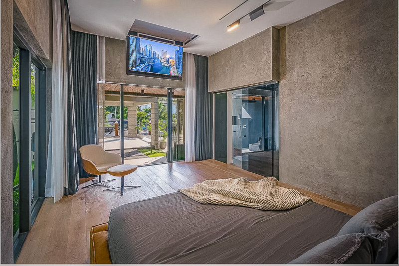 Master bedroom inside this luxury vacation rental in Miami