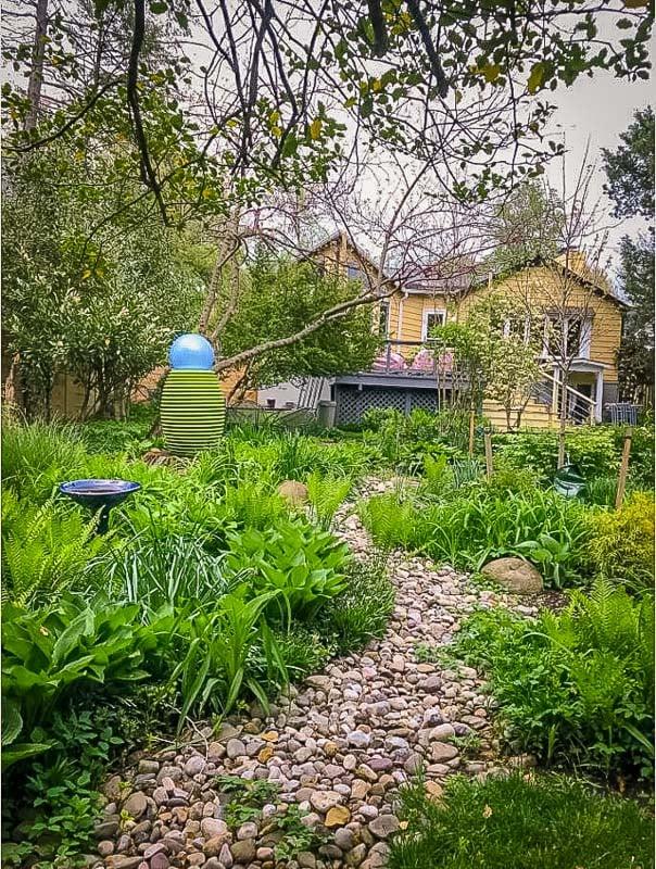Backyard with patio and hammocks.
