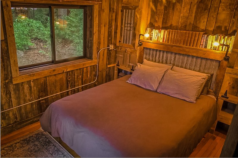 Cozy bedroom with rustic custom-built furniture