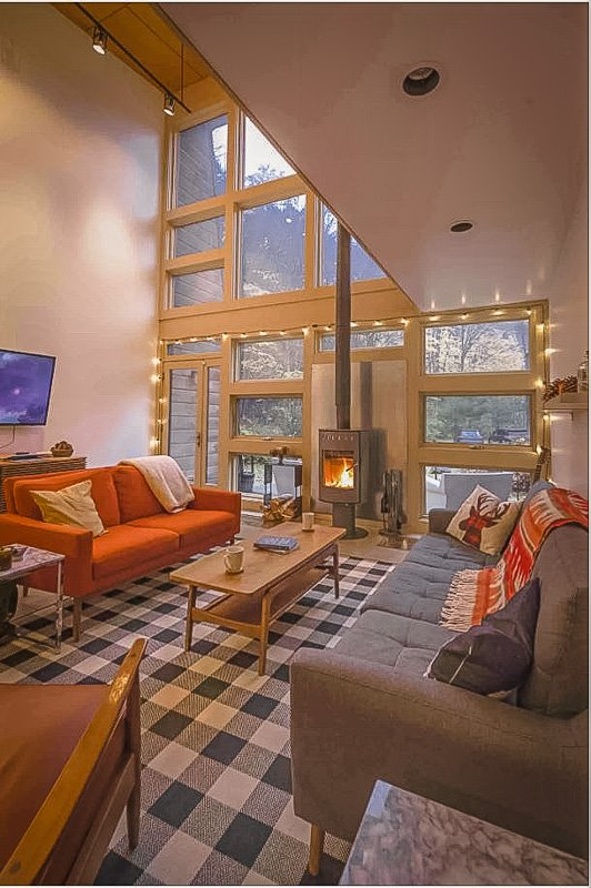 High ceilings and modern decor inside this New England cabin rental