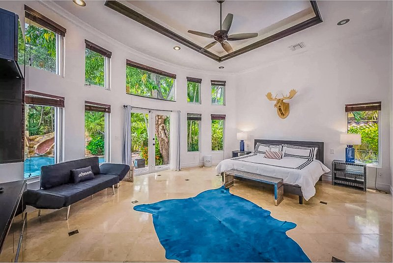 Master bedroom that opens directly to the pool deck, which is among the most unique Airbnbs in Florida.