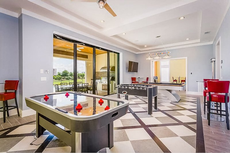 Game room with air hockey and foosball