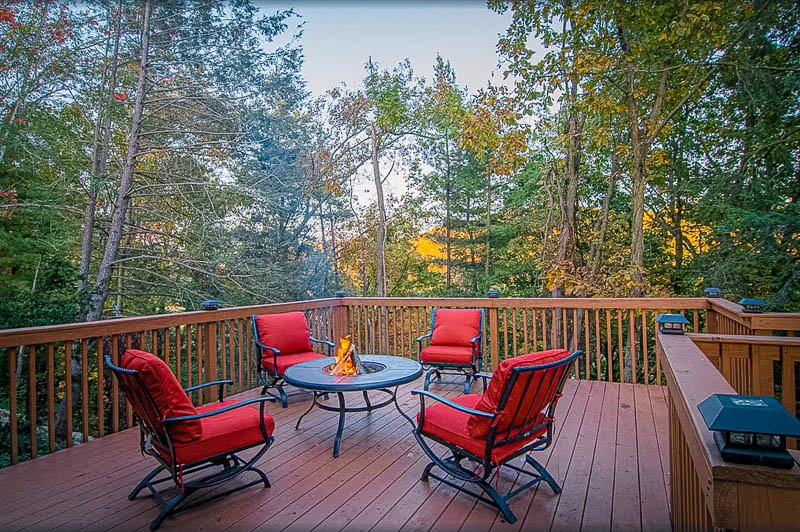 Spacious porch with outdoor furniture and fire pit