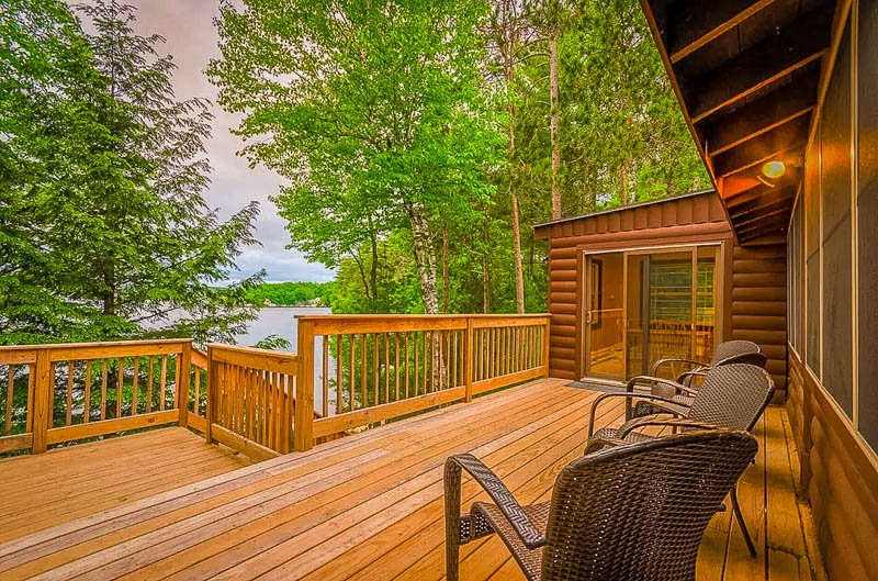 Expansive deck with stunning lake views from the cabin rental