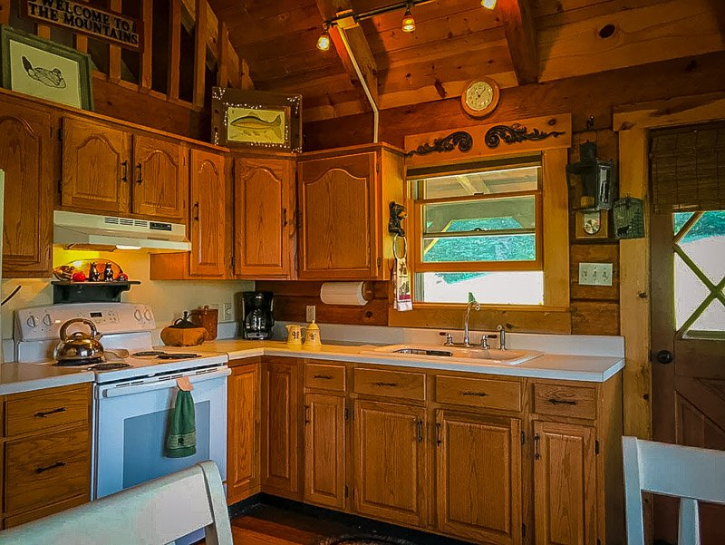 Fully equipped kitchen with rustic log cabin finishings