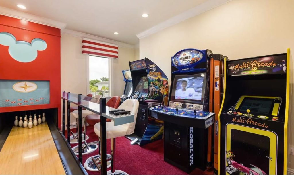 Indoor entertainment room, including bowling alley and arcade games.