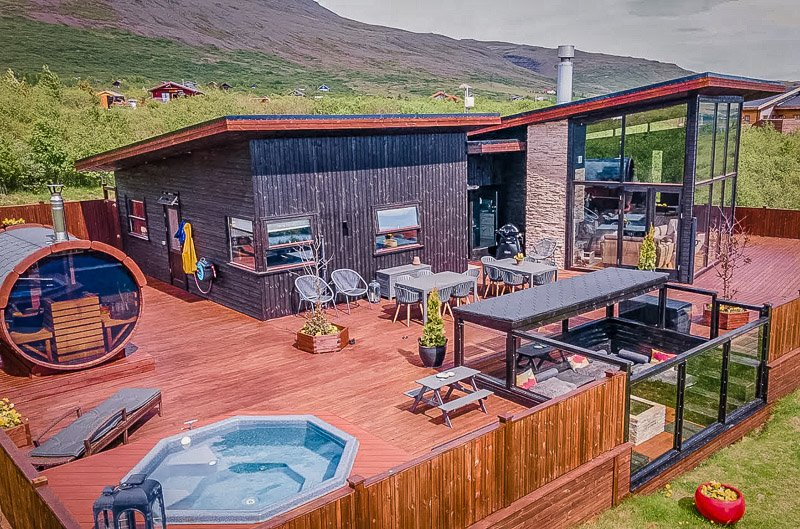 Iceland Airbnb for rent with private hot tub overlooking Icelandic scenery.