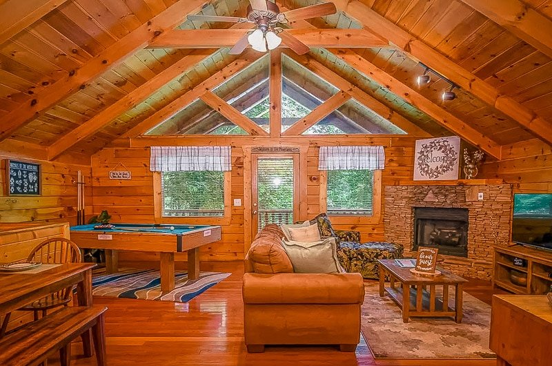 Cozy cabin living room area with a pool table