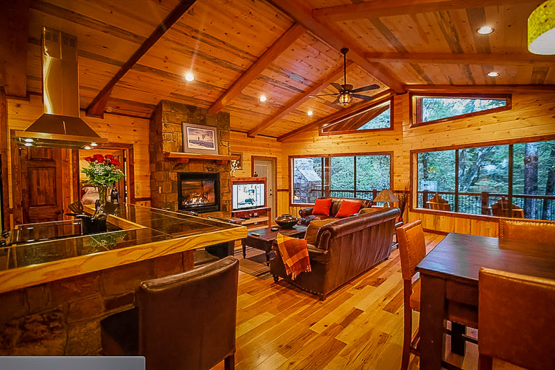 This log cabin rental in Oklahoma is decked out with a spa.