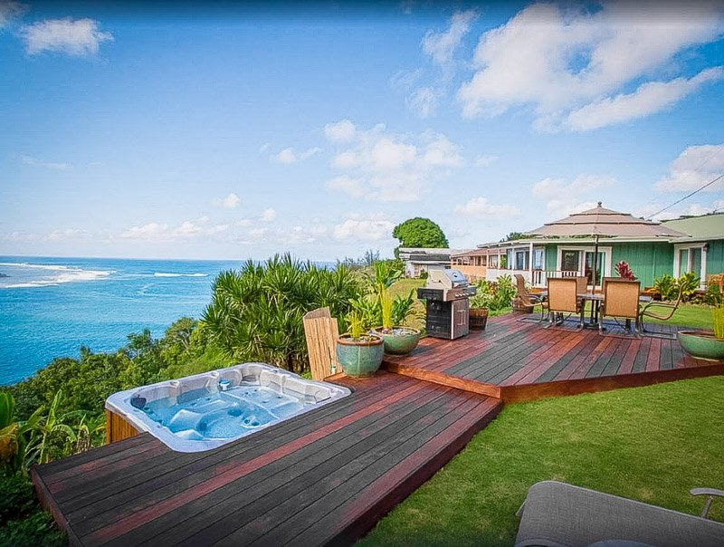 Enjoy spectacular views of the waterfront from this oversized jacuzzi