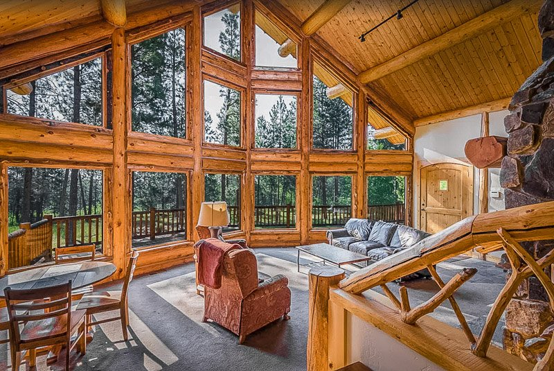 Rustic cabin decor with floor-to-ceiling windows