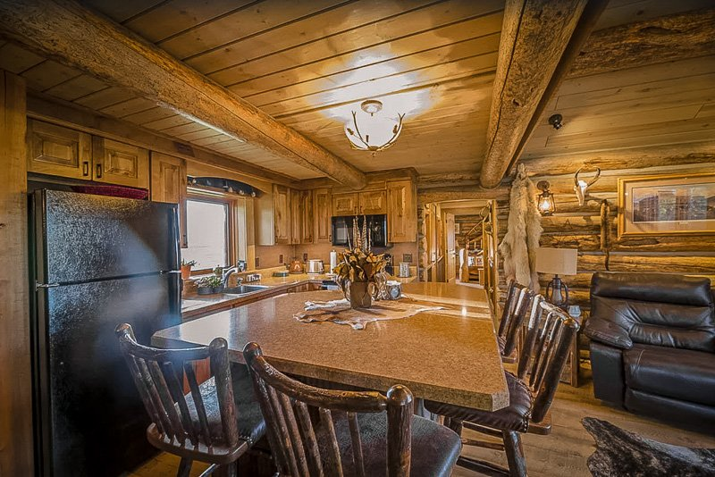 Beautiful kitchen space with rustic cabin-themed decor