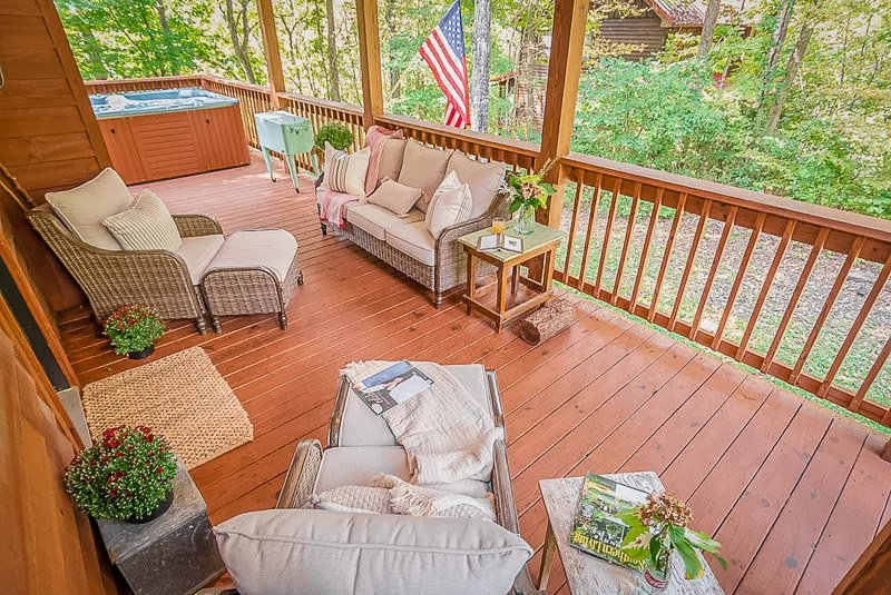 Hot tub on a deck overlooking the woods