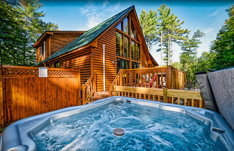 A cottage for rent in New Hampshire with a hot tub