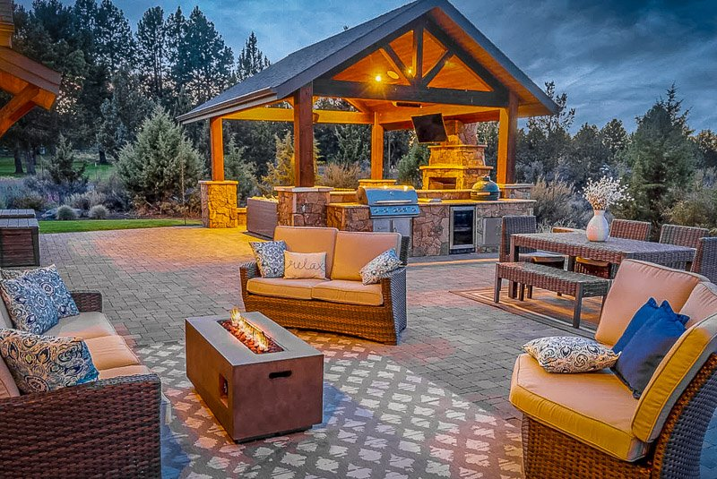 Gorgeous outdoor seating area with a grill and fire pit