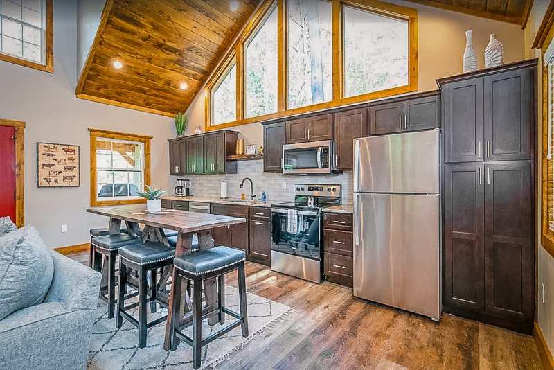 Open-concept layout featuring kitchen and dining area inside this Kentucky vacation rental