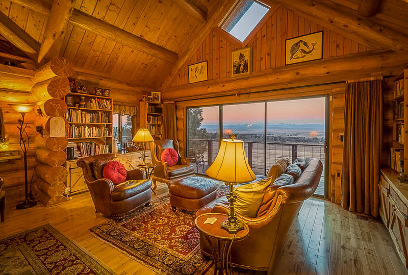 Rustic log cabin interior living space with a view
