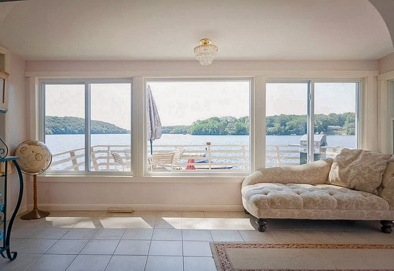 Family room at the CT weekend cottage with views of the lake.