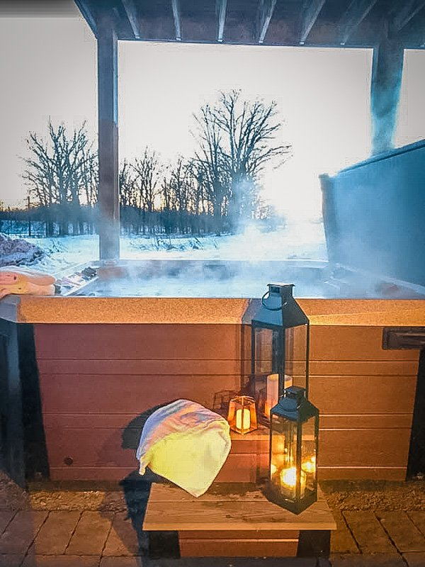 Outdoor hot tub to soak in after a long day of skiing