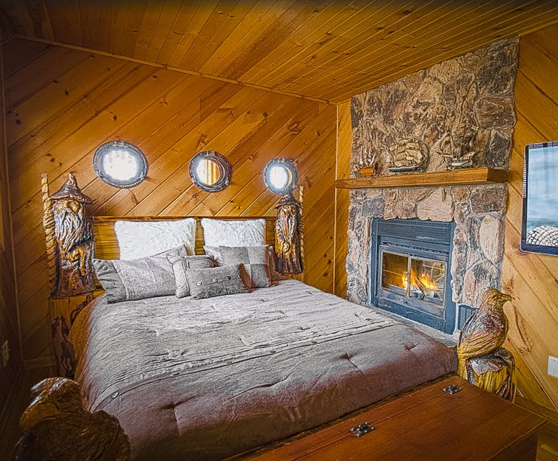Master bedroom with cozy fixtures inside one of the best cabin rentals in Minnesota
