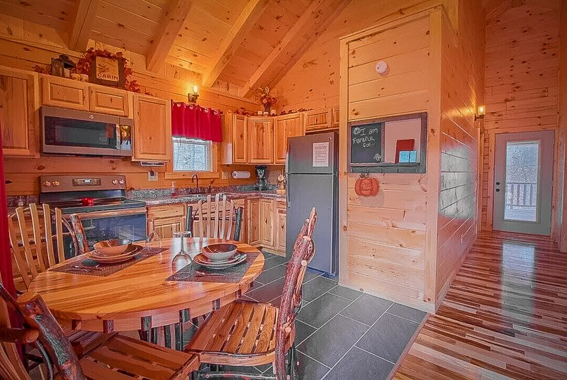 Cozy kitchen inside this OH log home for rent