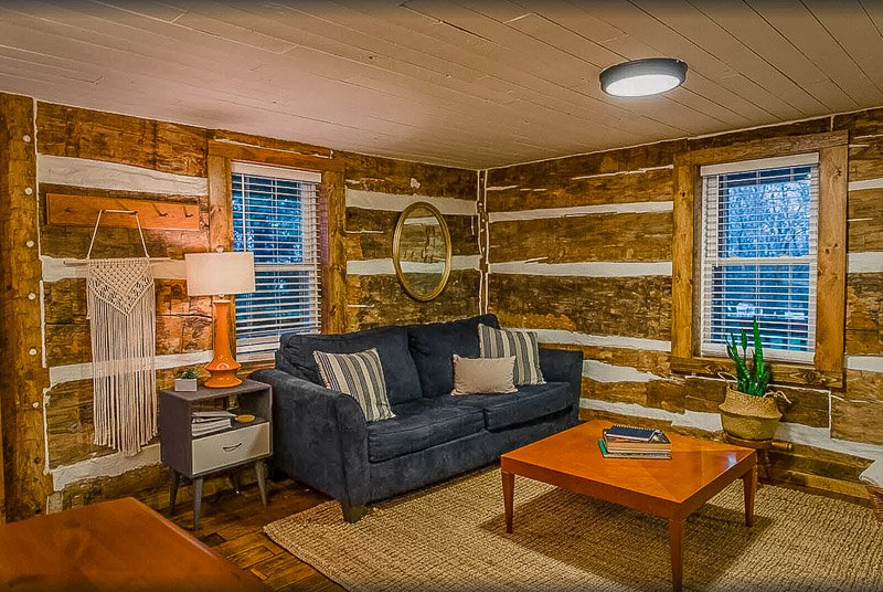 Cozy living room space inside this Indiana cottage rental on Airbnb and VRBO