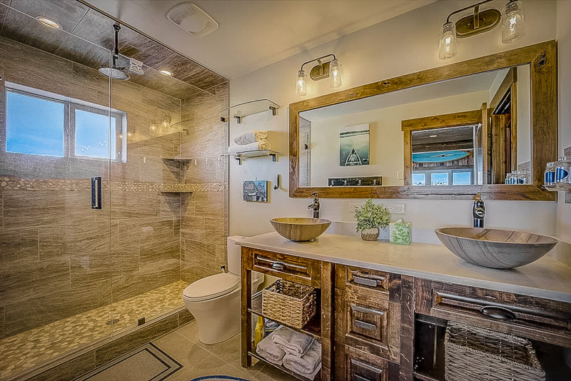 Modern bathroom inside this rustic UT vacation home