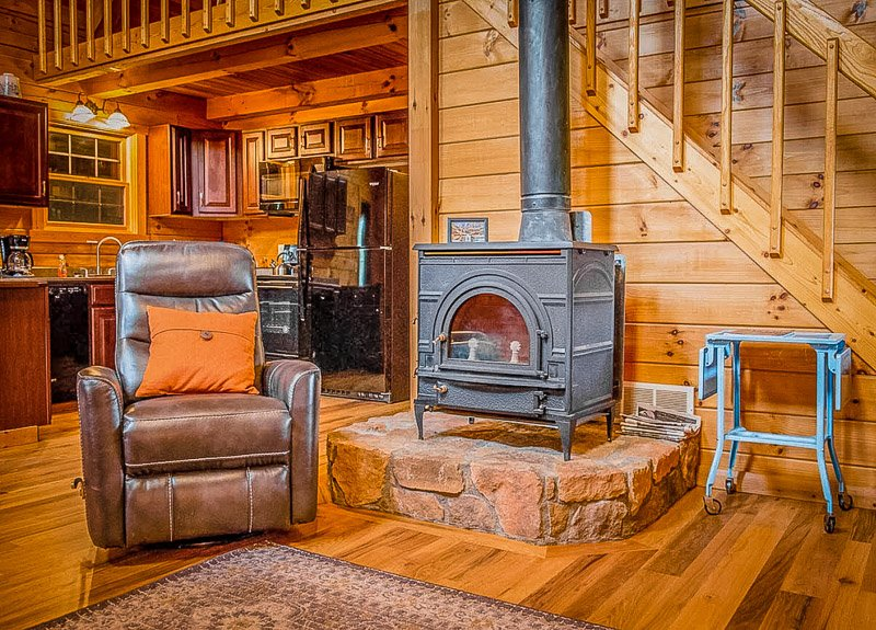 Cozy cabin vibes with indoor fireplace.