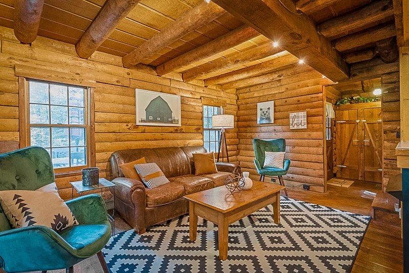 Rustic interior living space inside this IN cabin rental