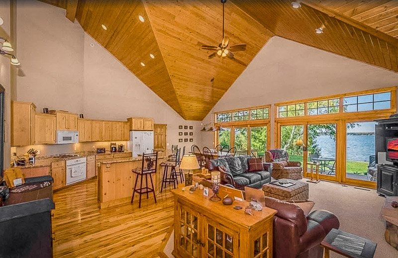 Rustic lodge-style kitchen and living room with plenty of seating