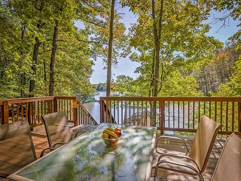 Outdoor deck with a view of the waterfront from this lake cabin rental in Ohio