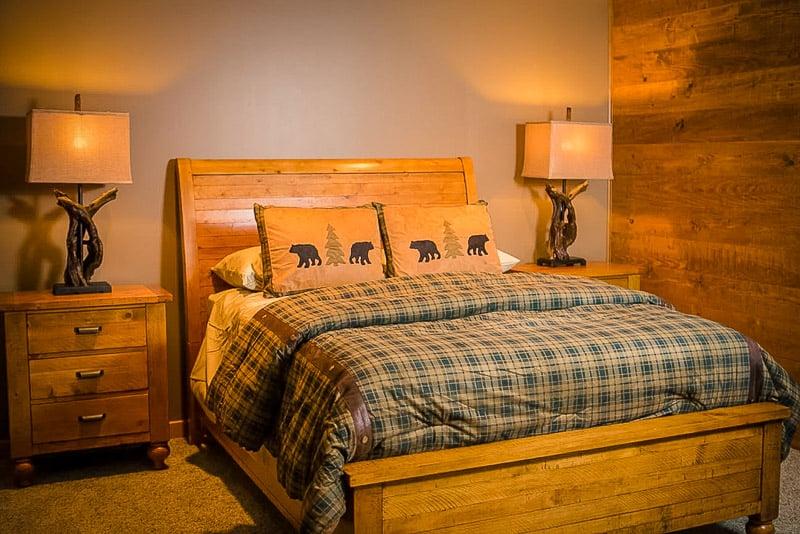 Master bedroom with quaint cabin decor