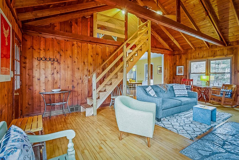 Log cabin style architecture with mid-century decor