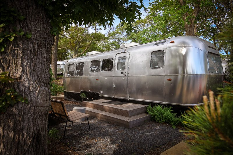 This 31ft airstream is decked out with a bedroom, bathroom sitting area, and fully-functional kitchenette.