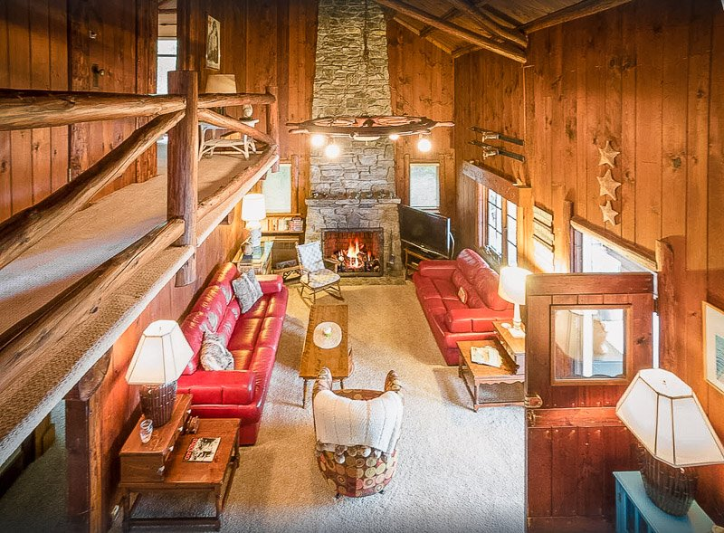 Cozy log cabin vibes at this NY lakefront property for rent on VRBO and Airbnb