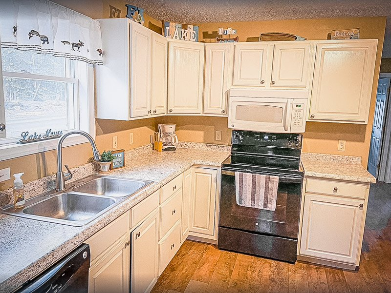 Fully equipped kitchen inside this lakefront rental in ME