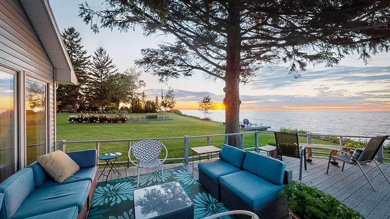 Gorgeous waterfront views from this NY lake vacation getaway.