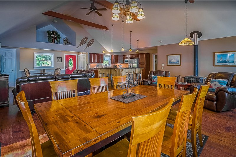 Dining room and living room inside this Maine lake cottage rental
